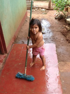 Diana cleaning the front porch of the school