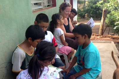 Annissa Walsh reading with the children