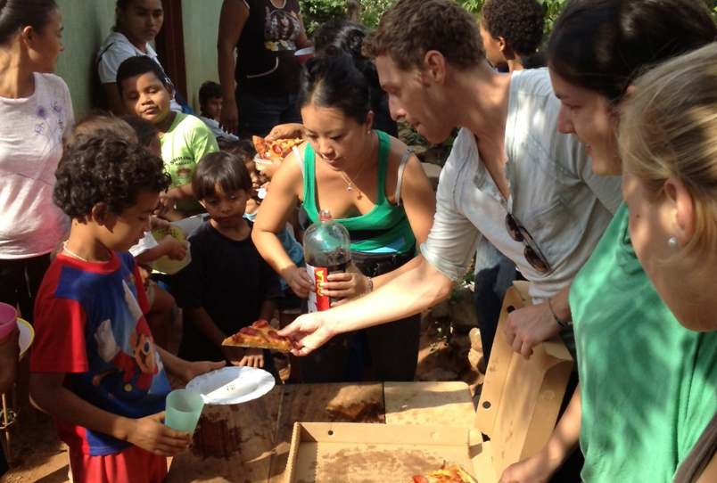 Joel serving Pizza to the kids on Thanksgiving day, 2012