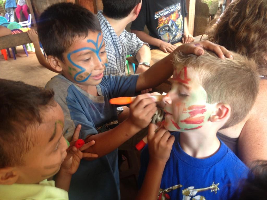 Andi paints volunteer's face :)