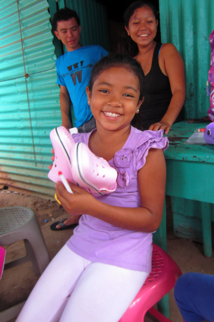 Prisila receiving shoes from Education Plus at Christmas